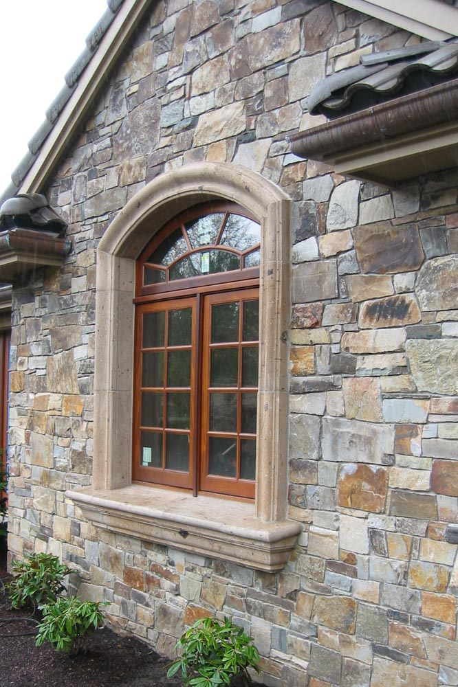 Palladium Stone Around Window : Custom stone details and cast center
