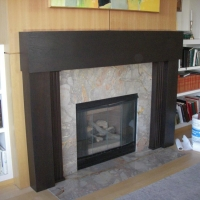 Marble Fireplace Surround and Wooden Mantle by Stone Center, Inc