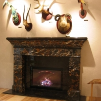 Michaelangelo Marble Fireplace by Stone Center, Inc